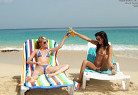 Lusty lesbians lick and toy each other on an exotic beach (nude photo 2 of 15)