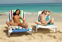Lusty lesbians lick and toy each other on an exotic beach (nude photo 12 of 15)