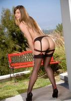 Adrienne Manning teasing outdoors in sexy black stockings (nude photo 10 of 16)