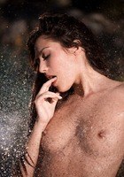 Irresistible goddess Cassie Laine gets naked and wet outside (nude photo 6 of 16)