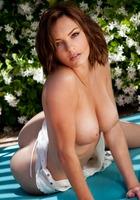 Dakota Rae Undressing in the Garden (nude photo 11 of 16)