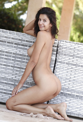 16 Pics: Gorgeous brunette babe Adelle stripping nude outdoors