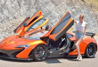 Cute slender teen Anya posing on road next to sports car (nude photo 1 of 16)