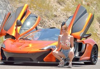 Cute slender teen Anya posing on road next to sports car (nude photo 2 of 16)