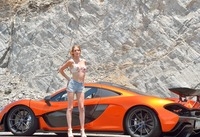 Cute slender teen Anya posing on road next to sports car (nude photo 3 of 16)