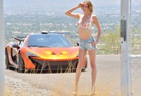 Cute slender teen Anya posing on road next to sports car (nude photo 5 of 16)