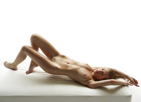 Slender naked model Katia all oiled up in studio nudes (nude photo 4 of 16)