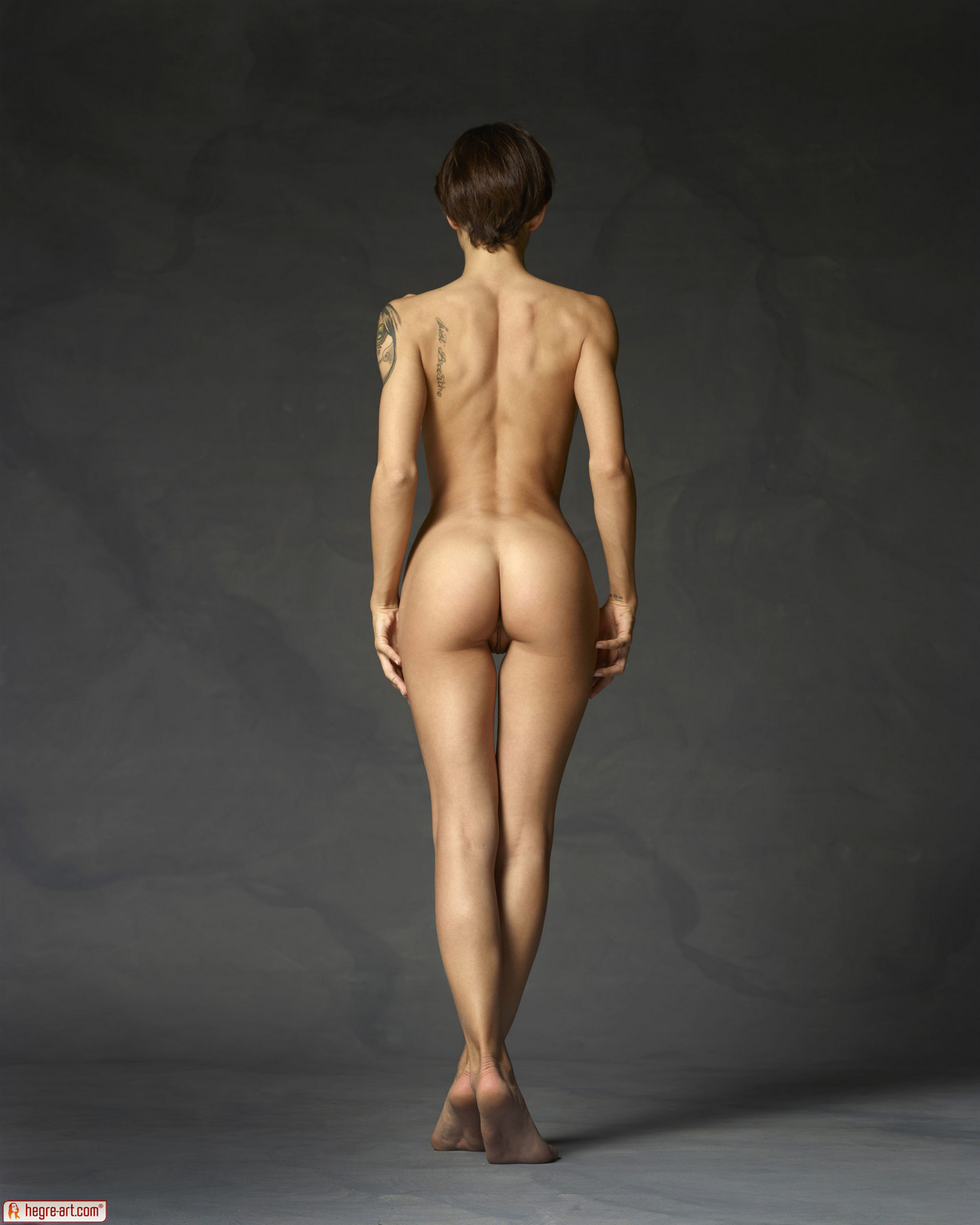 Nude woman with a beautiful booty stock image