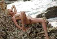 Mila posing nude on rocks (nude photo 9 of 18)