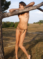Mouthwatering Maya plays and teases naked under a tree (nude photo 8 of 12)