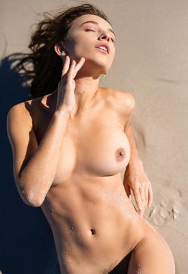 12 Pics & Free Video: Gloria Sol stripping bikini off on the beach in Playboy photos