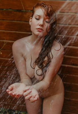 12 Pics & Free Video: Curvy redhead goddess Amber Rose in outdoor shower for Playboy