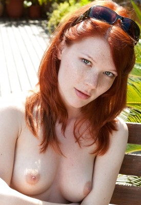 12 Pics: Mia Sollis passionately fingers her pussy on a bench outside