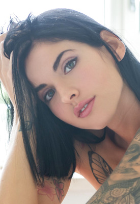12 Pics: Stunning brunette babe Nesty stripping naked in set by Suicide Girls