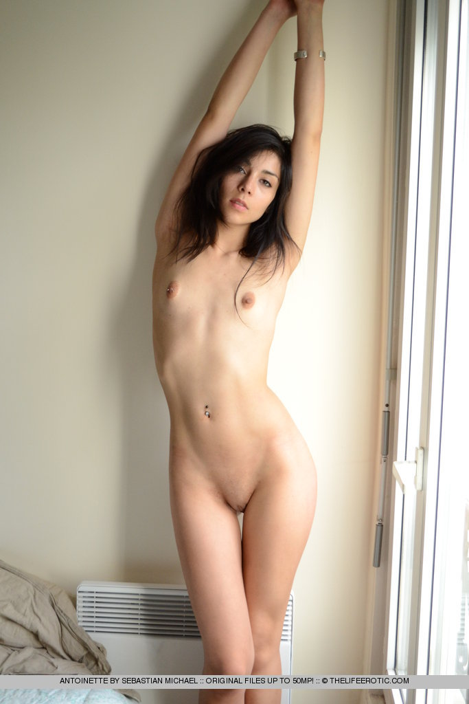 Brunette nude stretching