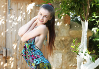 Curvy teen Emily gets undressed and plays in the garden (nude photo 3 of 16)