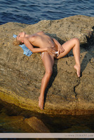 Blonde nude on the rocks (nude photo 5 of 12)
